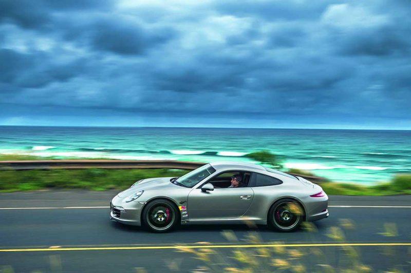Robby Naish in seinem Porsche